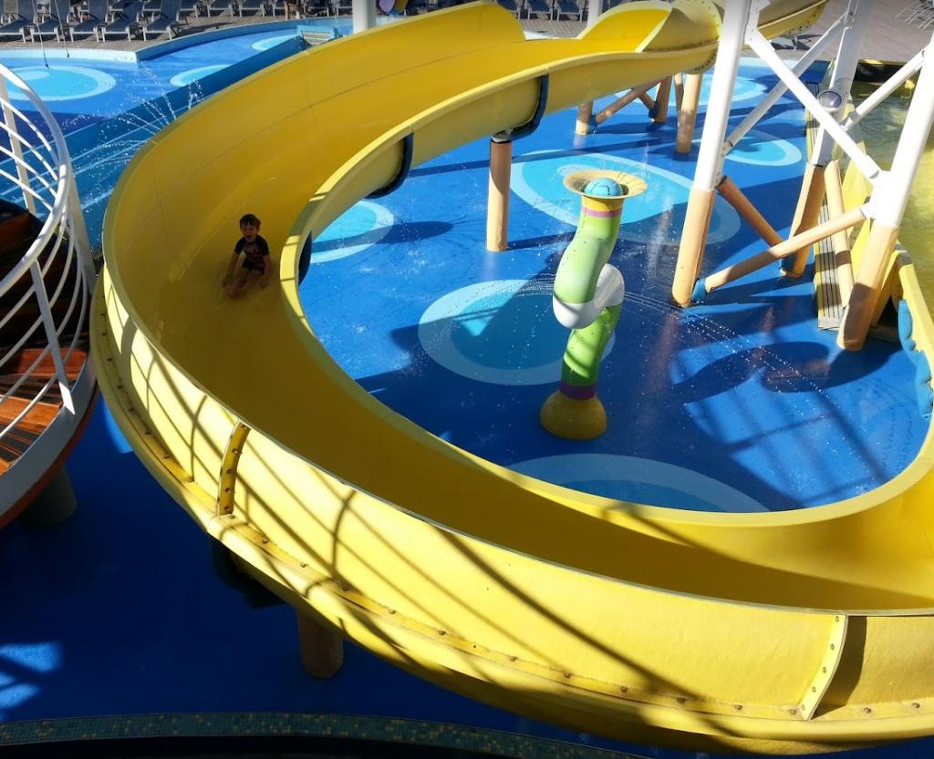 Kids enjoying the water slide on a Disney cruise ship.