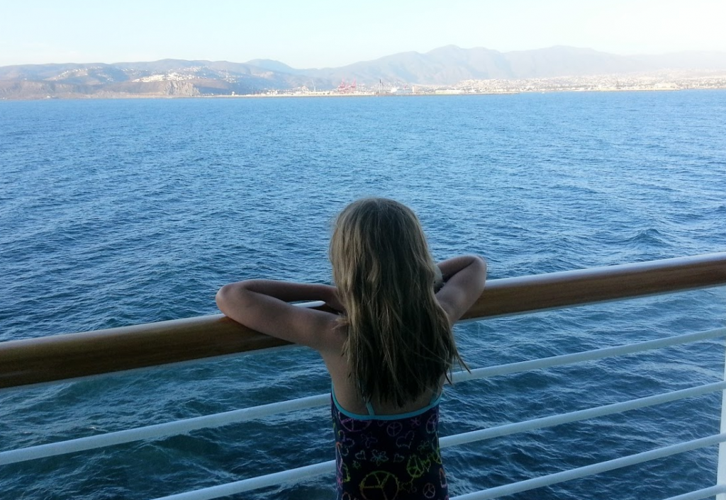 Looking over the cruise ship railing.