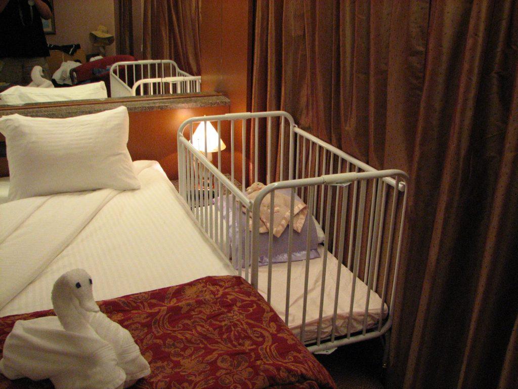 Cruise ship cabin with crib.