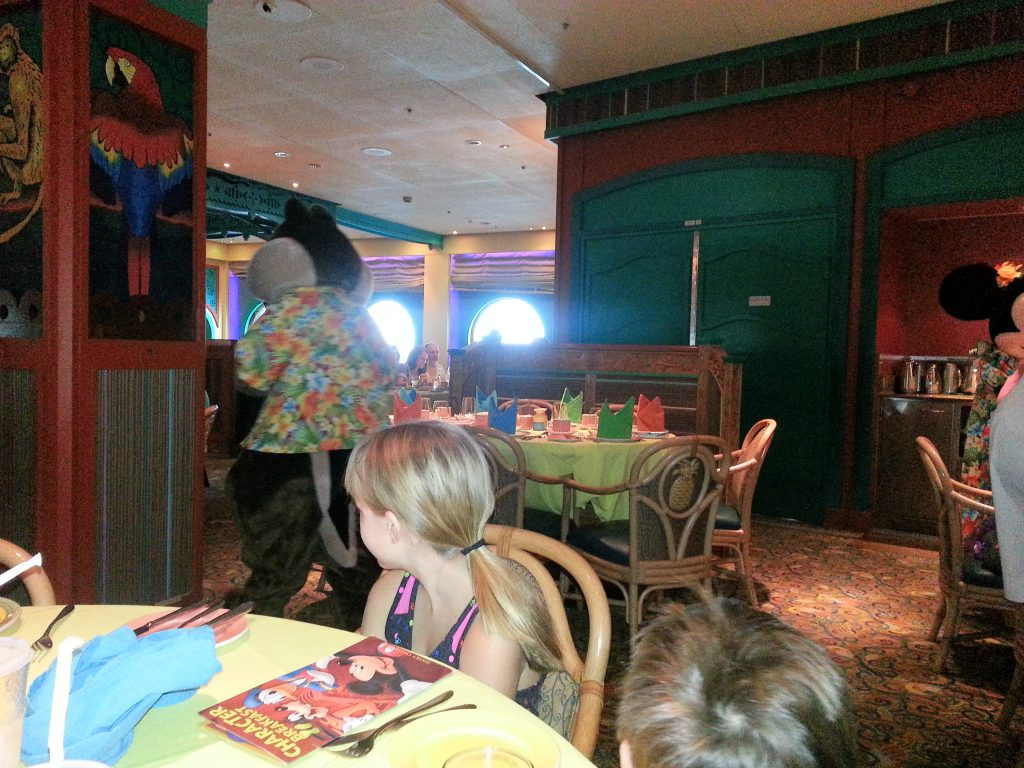 Watching characters in dining room on Disney cruise.