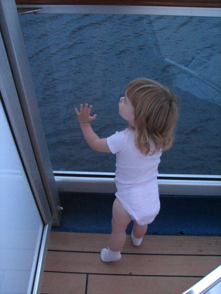 Toddler Looking out Cruise Ship Balcony